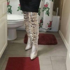 Snake skin thigh high stallito boots